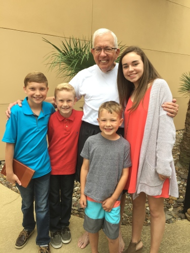 Grace with her cousins and Granddad